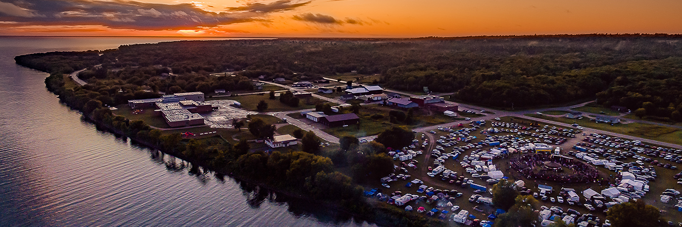 Red Lake Nation Pow wow with the sun set over lower red lake
